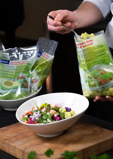 Salad with avocado dices and edible flowers