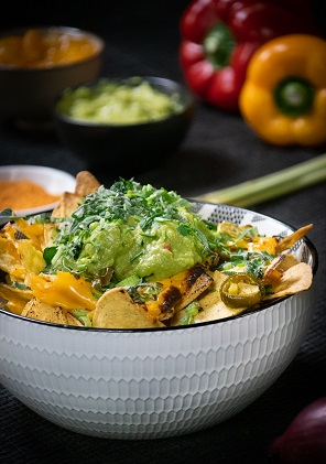 Loaded nachos with cheddar cheese sauce & guacamole topping