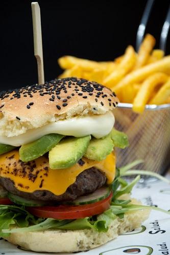 Burger with avocado slices