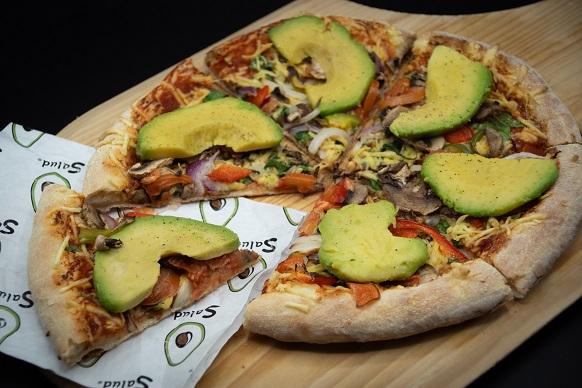 Pizza with avocado slices